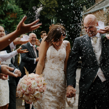 Guests Throwing Confetti on Wedding Day